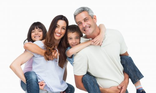 Smiling parents holding their children on backs on white background